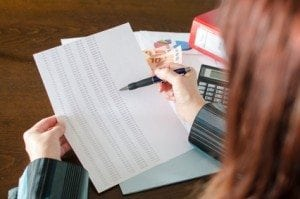 Female accountant checking financial documents